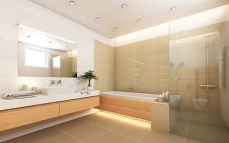 Beige themed bathroom with tub, shower in glass, and whit sink counter tops