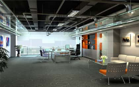 Clean modern office with an orange and grey color them.
